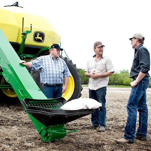 Three Farmers by the equipment